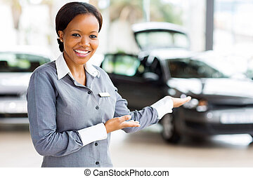 african car saleswoman presenting