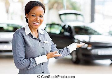 african car saleswoman presenting