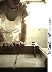 African Carpenter Restoring Antiques