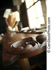 African Carpenter Sanding Antiques