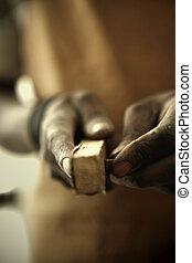 African Carpenter Sanding Antiques