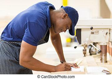 african carpenter working in workshop