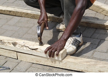 African carpenter works with wood