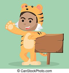 african child male in tiger costume with sign