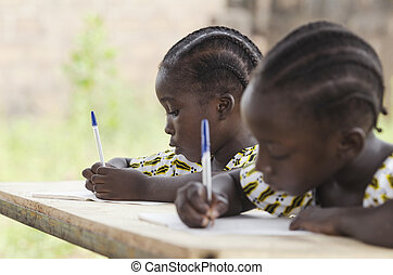 African Children at School Doing Homework. African ethnicity students writing their essay in an African school.