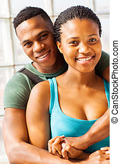 african college couple hugging