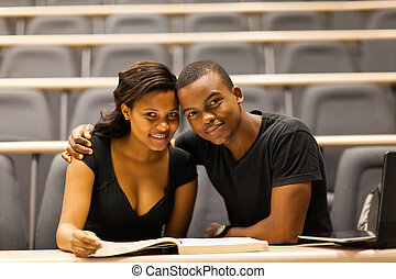 african college couple in lecture hall