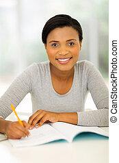 african college student studying at home