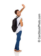african college student waving goodbye