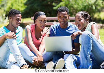 african college students using laptop computer