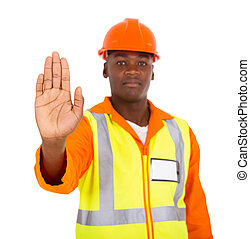 african constructor showing stop gesture on white background