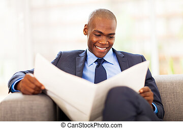african corporate worker reading