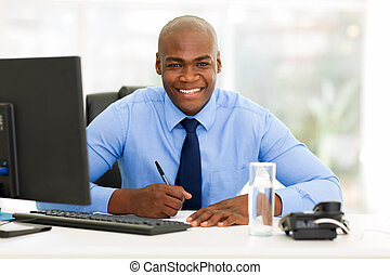 african corporate worker working in office