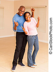 african couple celebrating in their new house
