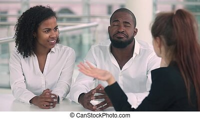 African couple happy to rent buy new house handshake realtor