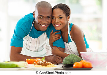 african couple in kitchen - cute african american couple in...