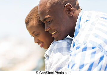 african couple looking down
