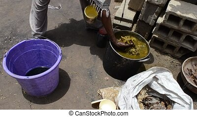 African craftsman - African man prepares natural dye for ...