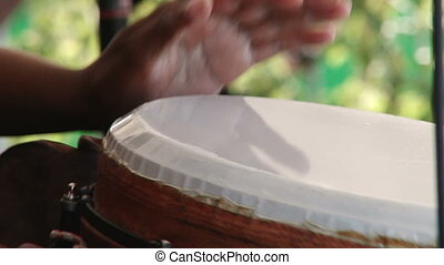 African drums - Man playing African percussion, conga