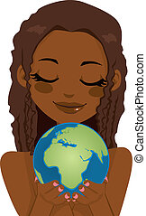 African Earth Woman - Beautiful African woman holding earth...