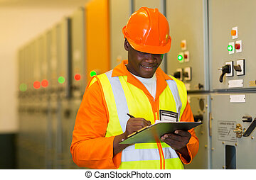 african electrical engineer in control room - african...