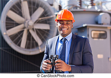 african electrical manager with binoculars