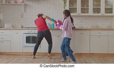African family fooling around with spray bottles - Excited ...