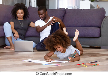 African family spend time at home sitting on warm floor