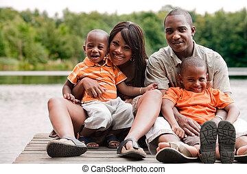 African familyon the wharf - Happy black family enjoying...