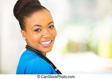 african female medical intern close up