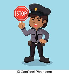 African female police holding stop sign