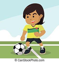 African female soccer player dribbling ball