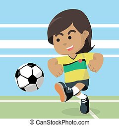 African female soccer player shooting ball