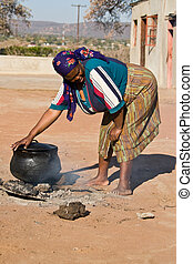 African Food - Three legged pot with traditional African...