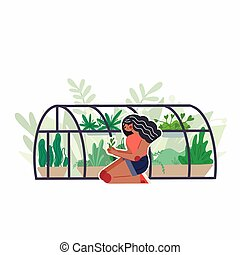 African girl care for home greenhouse with various plants. ...