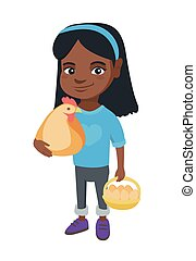 African girl holding a chicken and hen eggs.