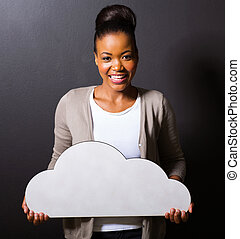 african girl holding white cloud