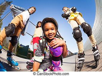 African girl in roller skates having fun outdoors