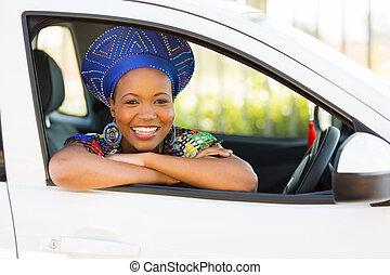 african girl inside her new car