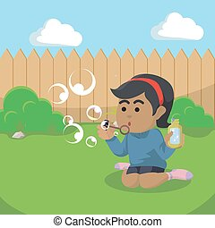 african Girl playing with soap bubble