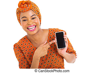 african girl pointing at smart phone - portrait of african...
