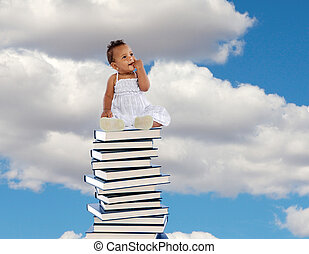 African girl sitting on a high stack of books