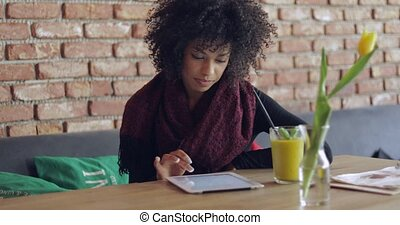 African girl using table in cafe