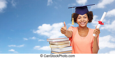 african graduate student with books and diploma