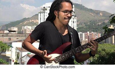 African Guitarist Playing Bass