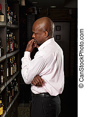 African guy in a wine shop