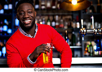 African guy posing with chilled beer - Smart young man...