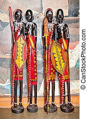 African handcraft dark wood carved people figures. Kenya, Africa.
