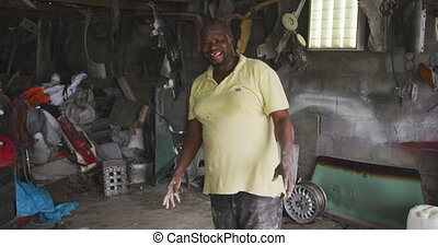African handyman smiling at camera - Portrait of a happy ...