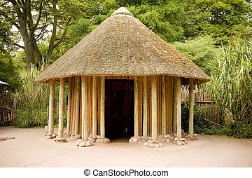 African Hut - A replica of an Africain hut in a park.